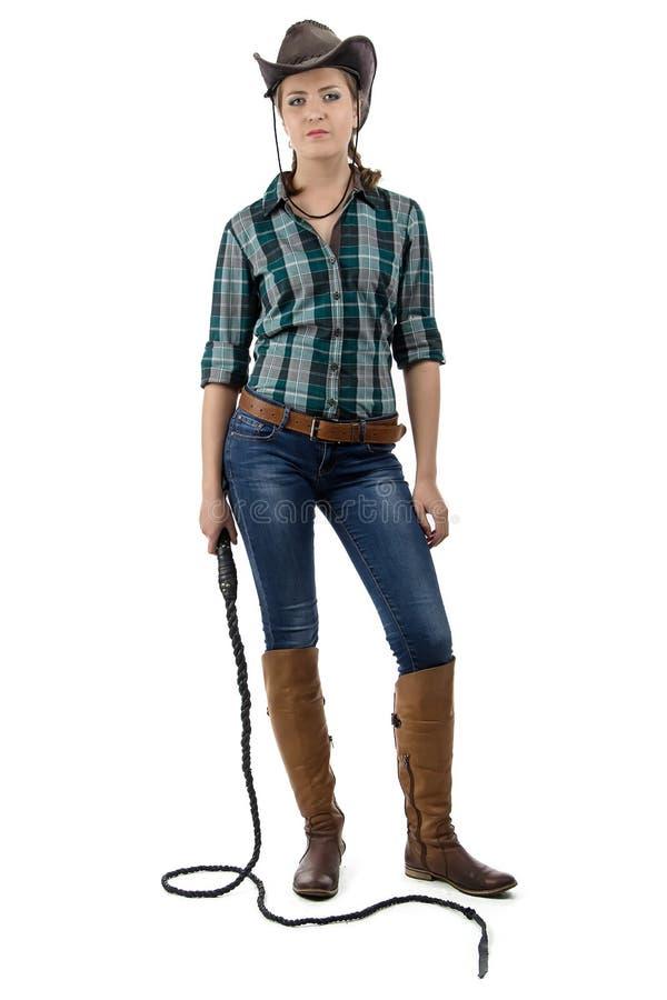 Foto del cowgirl con la frusta fotografia stock