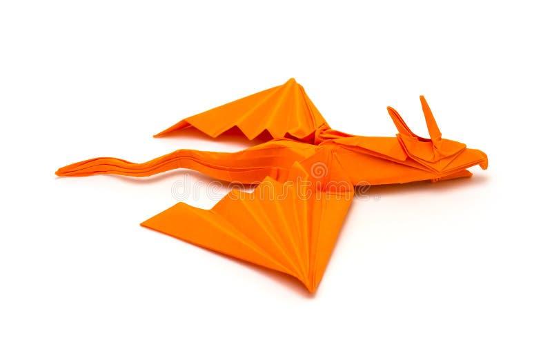 Foto del drag?n anaranjado de la papiroflexia aislado en el fondo blanco fotografía de archivo