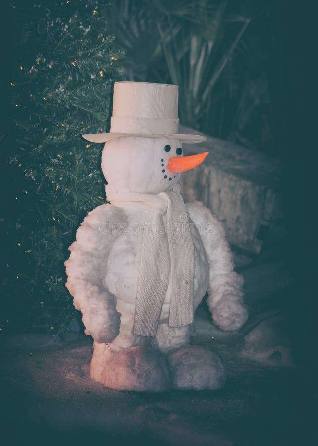 Foto del estilo del vintage de un muñeco de nieve imagen de archivo libre de regalías