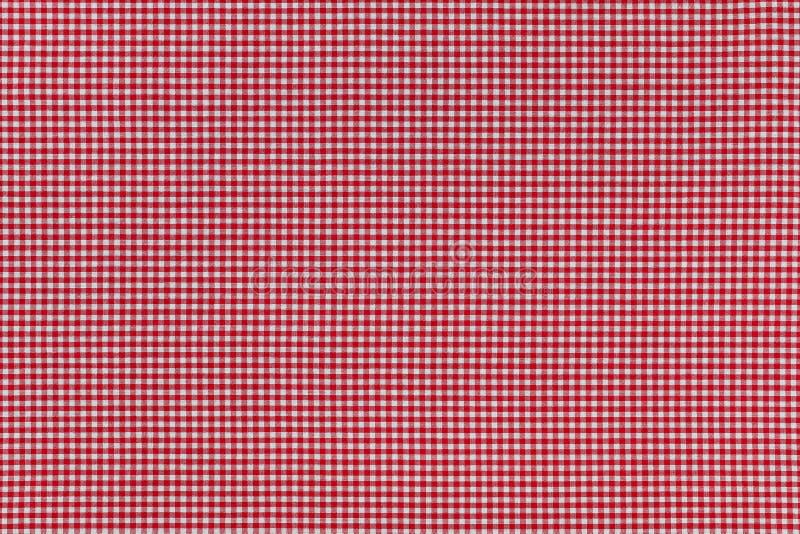 Foto del fondo di tessuto con il modello rosso controllato del percalle fotografia stock
