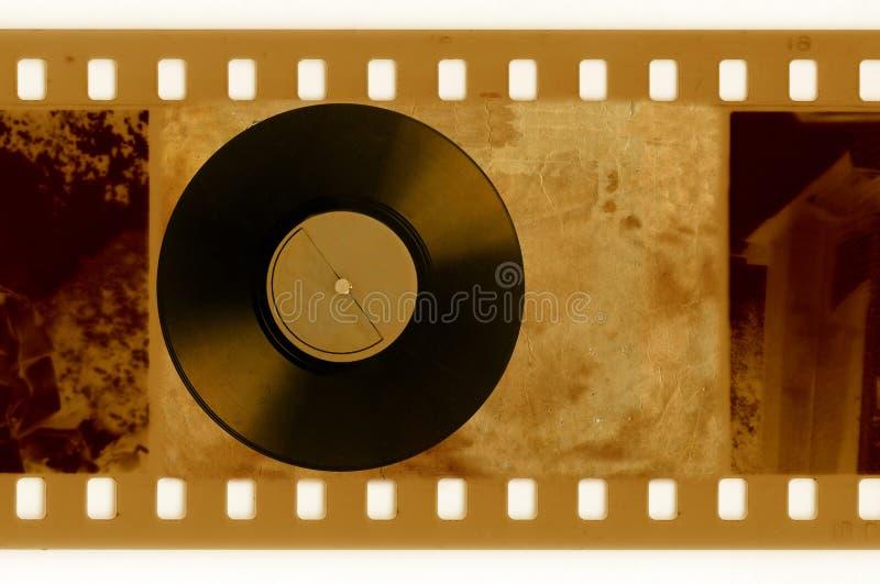 foto del marco de 35m m con el disco del vinilo de la vendimia stock de ilustración