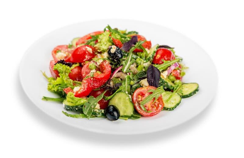Foto del primer de la ensalada fresca con las verduras adentro foto de archivo libre de regalías