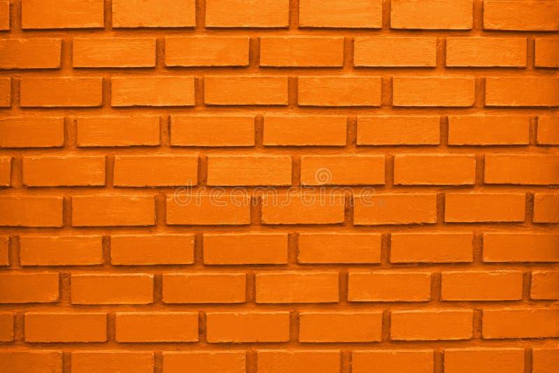 Foto del primer de la pared de ladrillo anaranjada imagen de archivo
