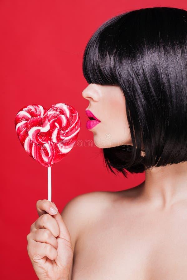 Foto del primo piano dell'belle labbra rosa sexy con immagini stock