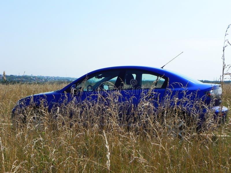 Foto dell'automobile in a piena vista Bello blu giapponese dell'automobile Dettagli e primo piano immagini stock