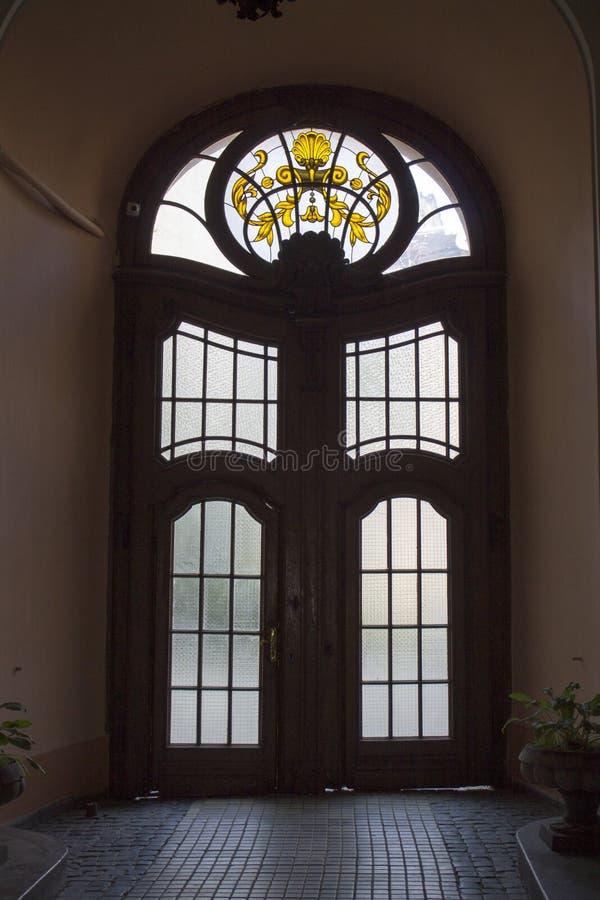 Foto della porta d'annata antica di vetro di vecchio stile fotografia stock libera da diritti