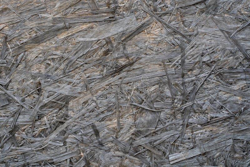 Foto der grauen Spanplattenbeschaffenheit in der nahen Ansicht stockfoto