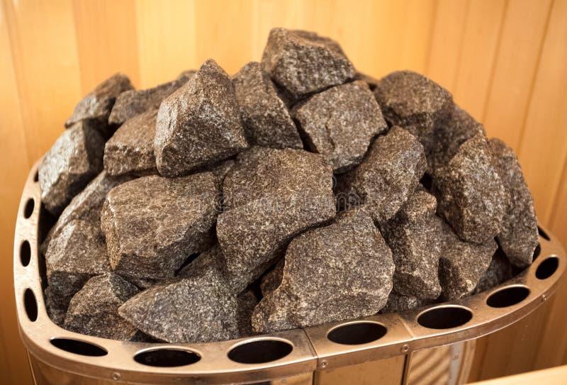 Foto des Granits schaukelt auf Ofen an der Sauna stockfotografie