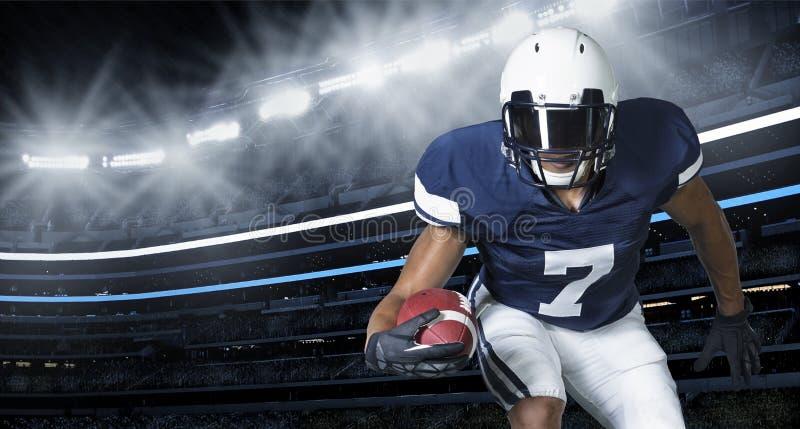 Foto di azione del gioco di football americano fotografia stock libera da diritti
