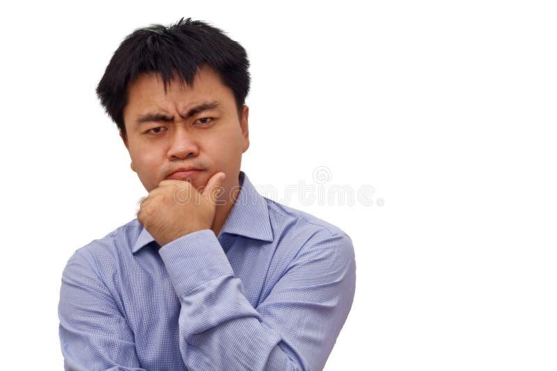 Foto di isolamento dell'uomo d'affari che pensa duro fotografia stock