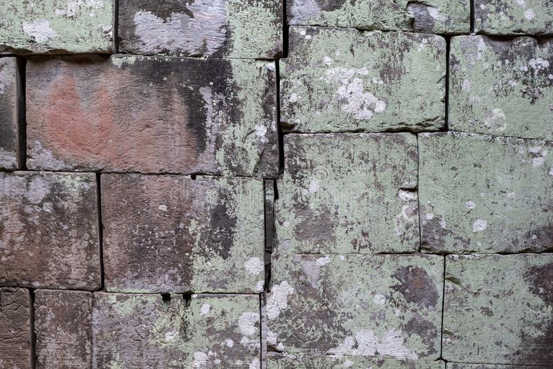 Foto di pietra grigia di struttura del mattone Priorità bassa di pietra naturale Sollievo stagionato della roccia Vecchia parete  fotografia stock