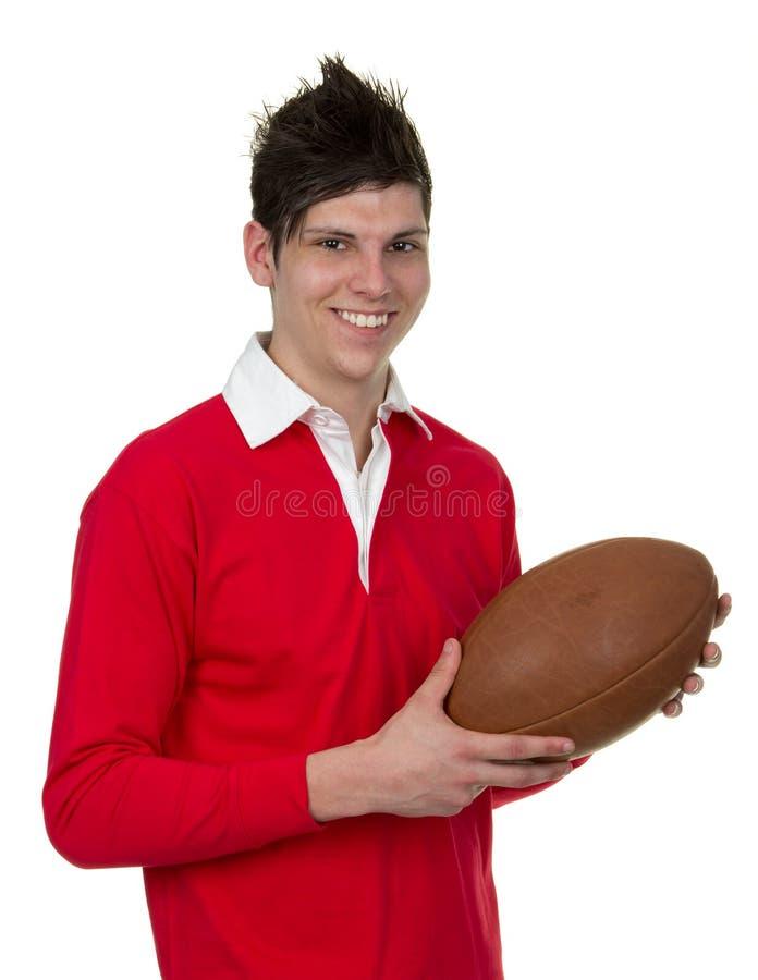 Foto di riserva di un uomo con una palla di rugby immagini stock libere da diritti