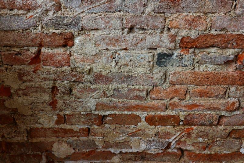 Foto do close-up da parede de tijolo vermelho, fundo marrom, velho do vintage fotografia de stock royalty free