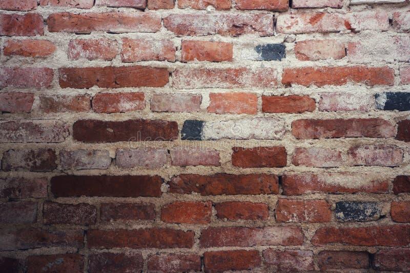 Foto do close-up da parede de tijolo vermelho, fundo marrom, velho do vintage imagem de stock