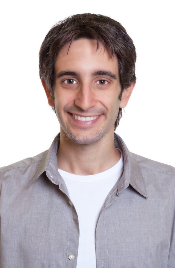 Foto do passaporte de um indivíduo em uma camisa cinzenta imagens de stock