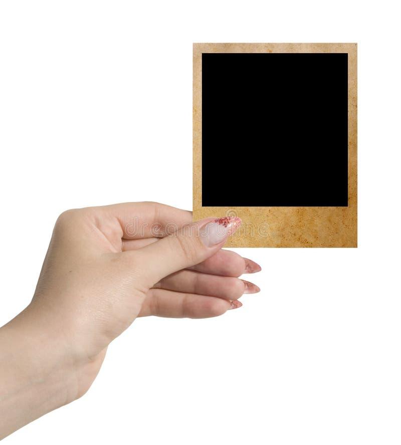 Foto in einer Hand stockfoto