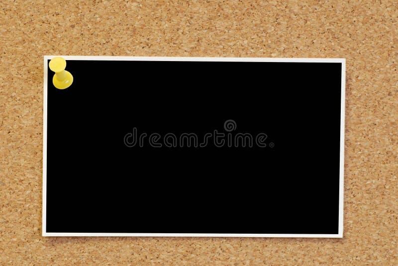 Foto em branco no corkboard fotos de stock