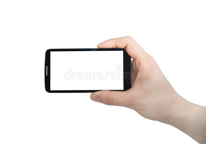 Foto för danande för telefon för manhandinnehav ett smart på den mobila closeupen för smartphone som isoleras på vit bakgrund royaltyfria bilder