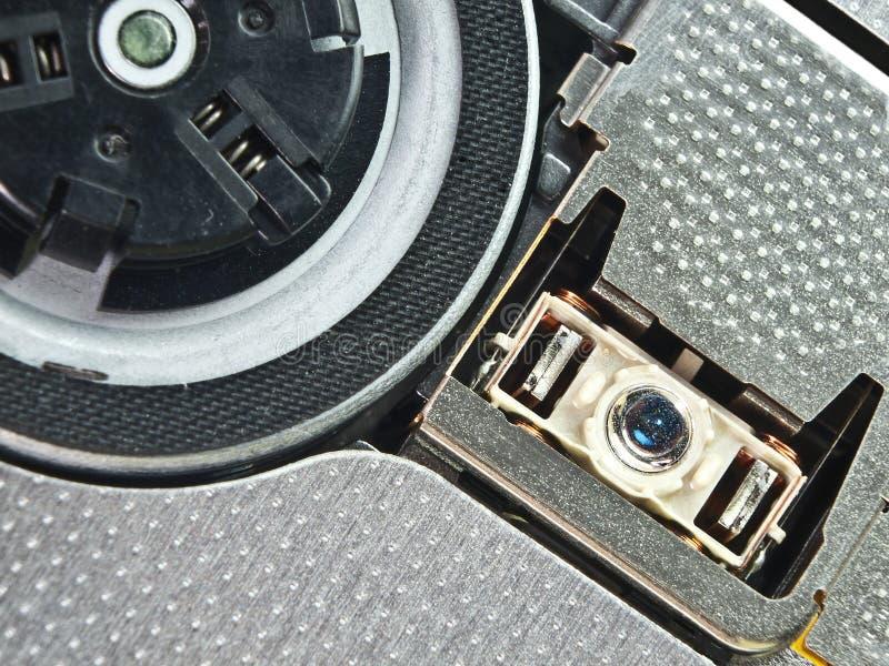 Foto macra de la lente y del sostenedor de DVD imagen de archivo