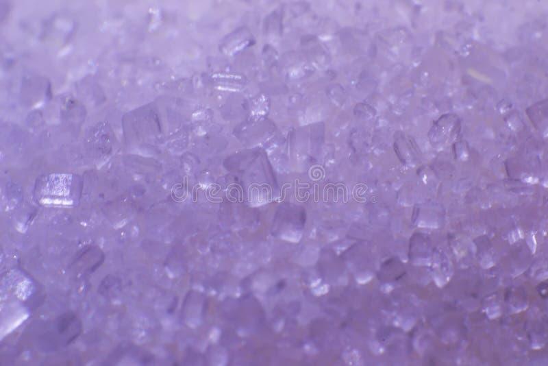 Foto macra de los cristales del azúcar, extracto fotos de archivo