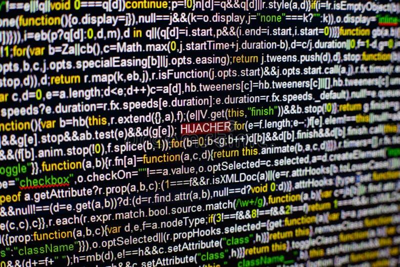Foto macro do tela de computador com código fonte do programa e da inscrição destacada do PIRATA DO AR no meio Roteiro sobre imagens de stock royalty free