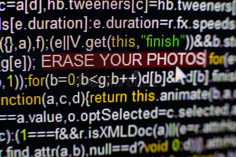 Foto macro do tela de computador com código fonte do programa e ERASE destacado SUA inscrição das FOTOS no meio fotos de stock royalty free