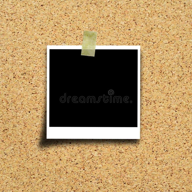 Foto no fundo da placa da cortiça imagens de stock royalty free