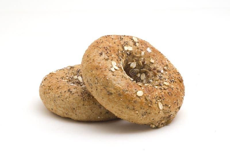 Doze Bagels da grão imagem de stock