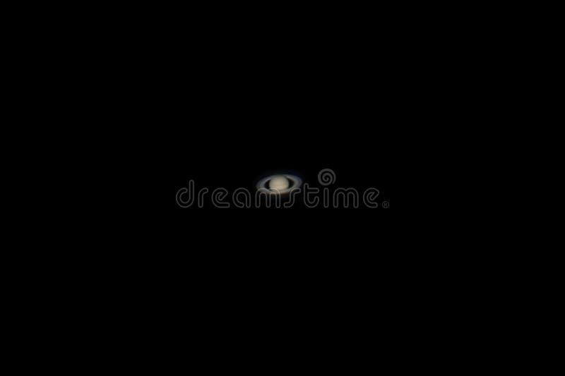 Foto real do planeta de Saturn com telescópio fotografia de stock royalty free