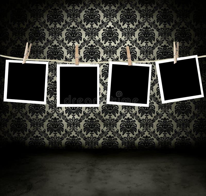 Foto's die in een donkere ruimte hangen stock illustratie