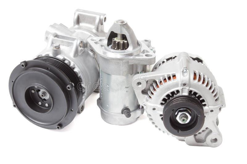Foto's op de samenstelling van de drie delen voor de motor Generator, airconditioningscompressor en de aanzet stock foto's