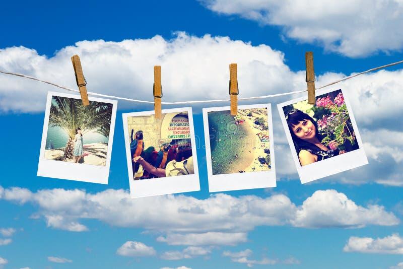 Foto's van vakantie het hangen op drooglijn door wasknijpers. stock illustratie