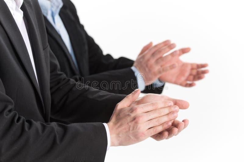 Foto van bedrijfsmensenhanden die bij witte achtergrond toejuichen royalty-vrije stock foto