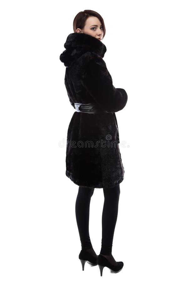 Foto van brunette in bontjas met kap stock foto
