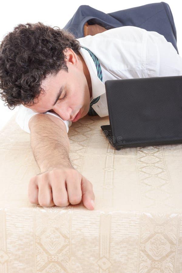 Foto van de uitgeputte, slaap en overwerkte bedrijfsmens met l royalty-vrije stock afbeeldingen