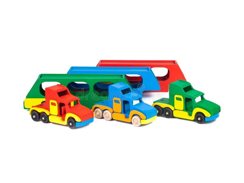 Foto van een houten stuk speelgoed vrachtwagen stock foto