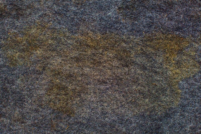 Foto van een oud grijs tapijt met vlekken De textuurachtergrond van Grunge stock afbeeldingen