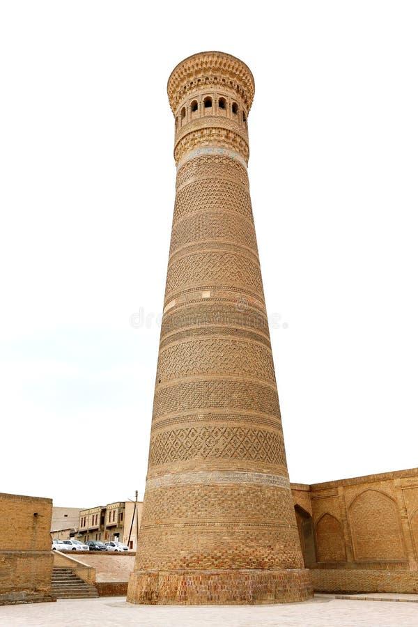 Foto van een oude mooie Oosterse minaret in Oezbekistan stock afbeeldingen