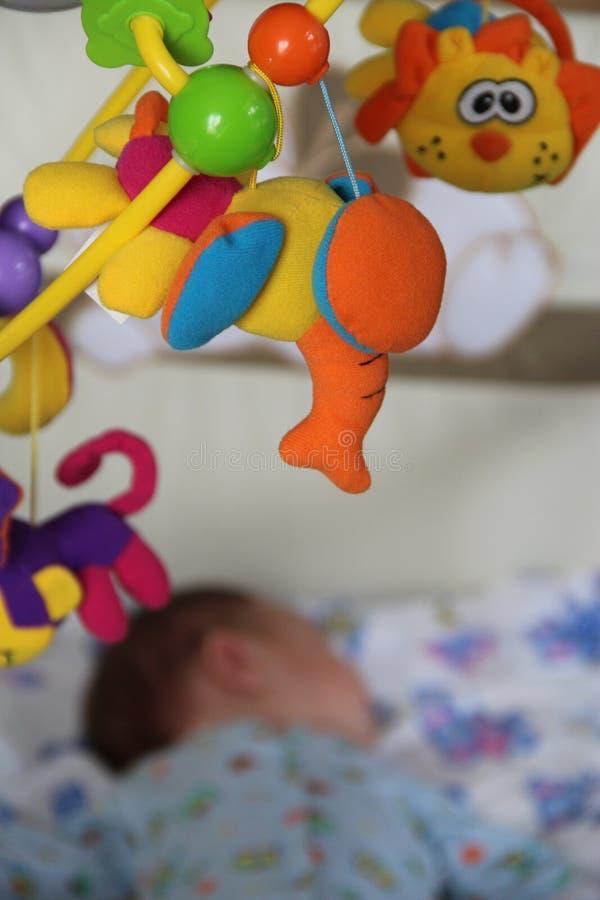 Foto van een speelgoed voor een krib stock afbeeldingen