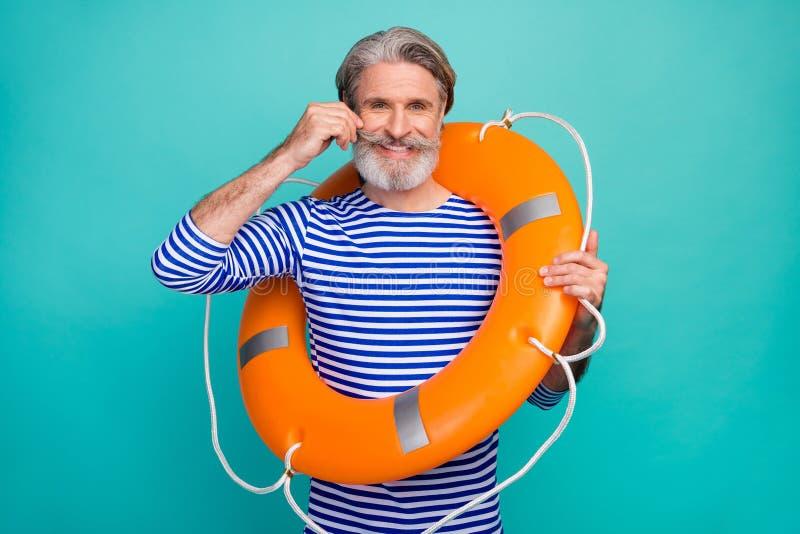 Foto van funky macho aged seaman hold orange security save life boy curling neat groomed mustache wear striped sailor stock afbeeldingen