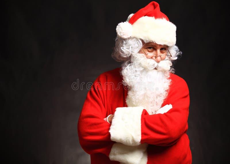 Foto van gelukkige Santa Claus in oogglazen stock afbeelding
