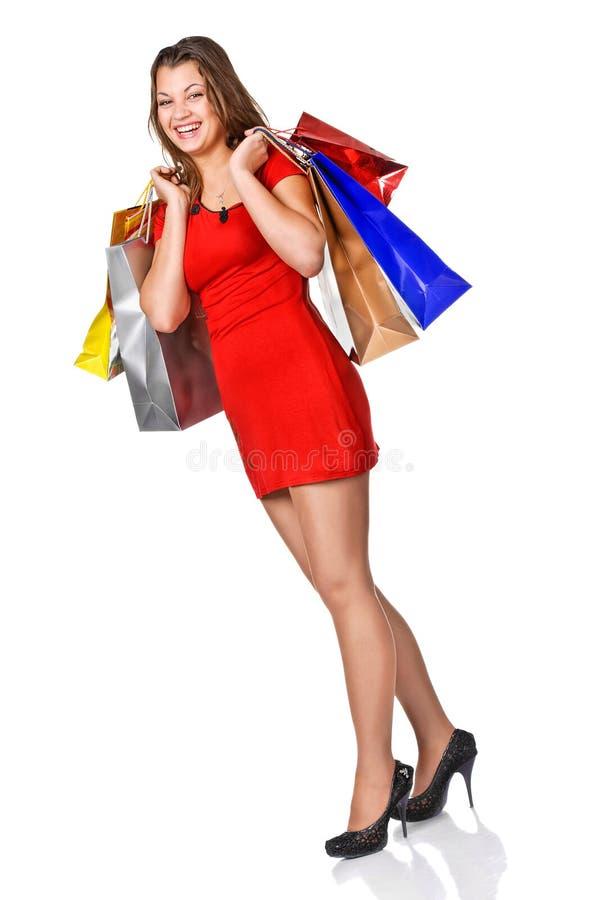 Foto van mooie vrouw met het winkelen zakken. royalty-vrije stock afbeelding
