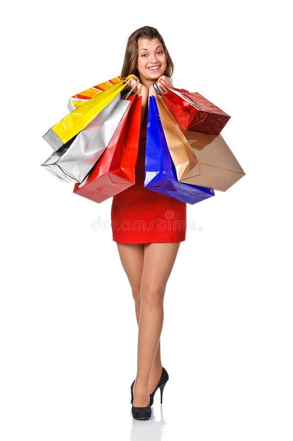 Foto van mooie vrouw met het winkelen zakken. stock fotografie
