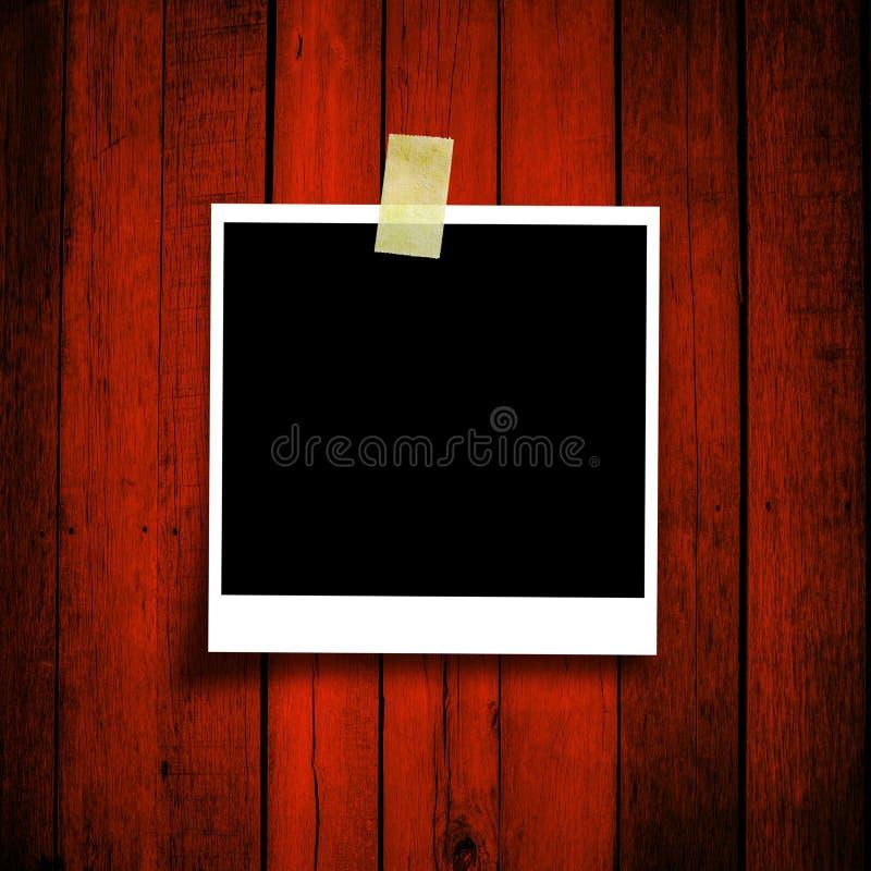 Foto vazia no fundo de madeira do grunge fotografia de stock
