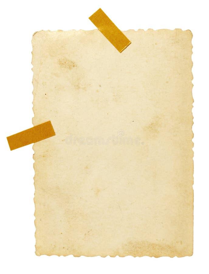 Foto vieja con el espacio en blanco del recordatorio de la nota de la cinta imagen de archivo