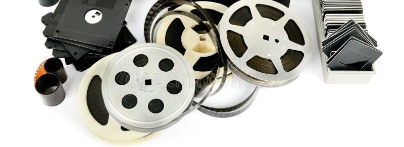 Foto vieja y equipo de vídeo aislados en el fondo blanco wide fotografía de archivo libre de regalías