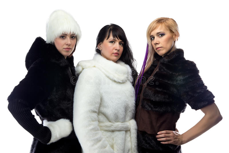 Foto von drei Frauen in den Pelzmänteln stockfotos
