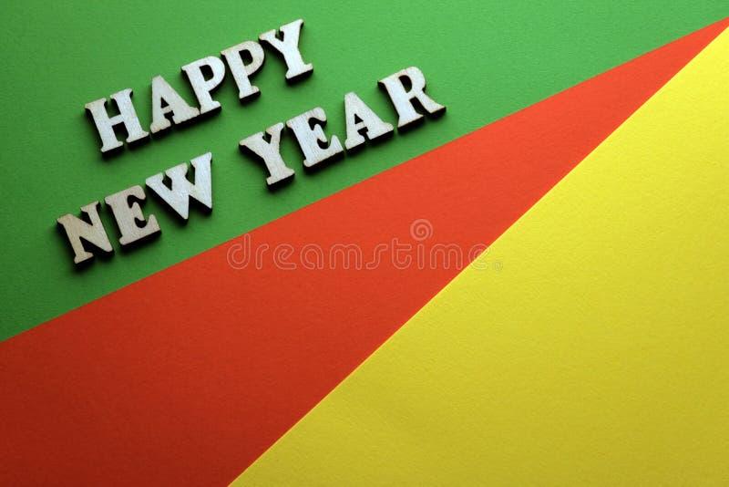 Foto voor nieuw jaar op de groene rode gele achtergrond royalty-vrije stock afbeeldingen