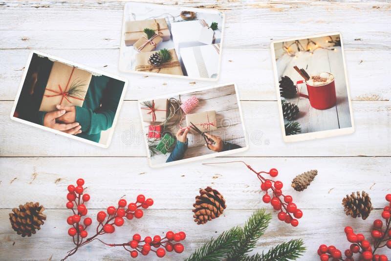 Fotoalbumet i minne och nostalgi i jul övervintrar säsong på den wood tabellen royaltyfri fotografi