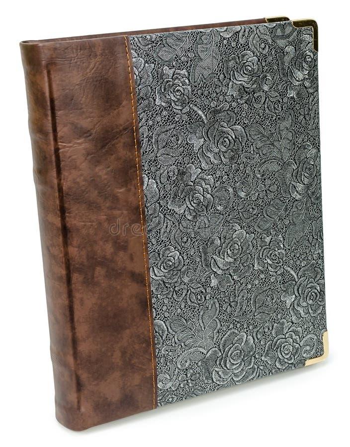 Fotoalbumet med lyx för silver för modellen för textilen för ecolädermyran blom- snör åt texturboken med rosor arkivfoto